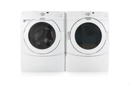 A front-load washer and dryer sitting side by side.